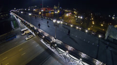 Citizens walk by Patriarshy bridge over embankment with traffic Stock Footage