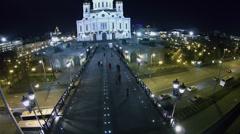People walk by Patriarshy bridge to Christ the Saviour Cathedral Stock Footage
