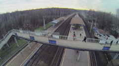 Train arrives to railway station with people at autumn Stock Footage