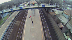 Train passes railway station with people at autumn day Stock Footage