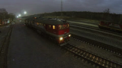 RZD company train starts ride by railroad track Stock Footage
