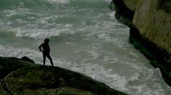 Rio De Janeiro man on rocky coast Stock Footage