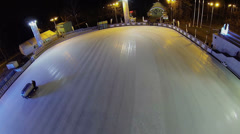 Two machines prepare ice of rink in park Sokolniki Stock Footage