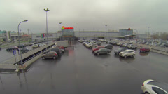 Large parking with many cars near shopping center Mall Gallery Stock Footage