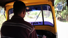 Driving rickshaw in India Stock Footage