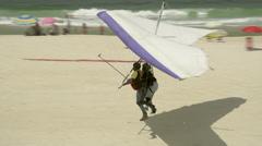 Rio De Janeiro beach hang glider landing Stock Footage