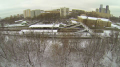 Passengers wait for train on urban railway station at winter Stock Footage