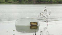 Flooded camping trailer in the lake after storm. Caravan, medium shot, 25fps. Stock Footage