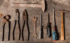 workbench with rusty tools - stock photo
