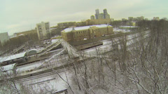 Trees covered by snow and urban railway station at winter Stock Footage