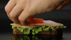 Woman preparing big sandwich with vegetables and cheese Stock Footage