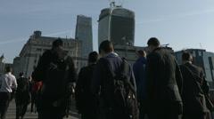 Large crowd of pedestrians walk over London Bridge 42. 4K version Stock Footage