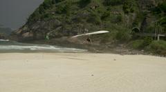 hang glider landing on beach in Rio De Janeiro Stock Footage