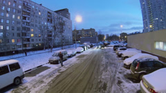 Car rides by road near car-wash and dwelling houses at winter Stock Footage