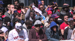 Crowds of sports fans cheer on their team - stock footage
