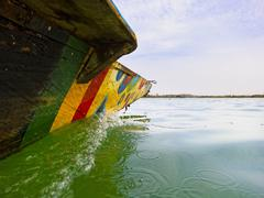 Traditional fisherman boat on the Niger river - stock photo