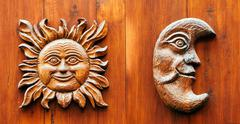 ancinet door with moon and sun face - stock photo