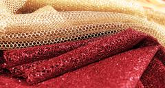 Golden and red fabric - stock photo
