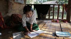 Working on Homework in Burma Stock Footage