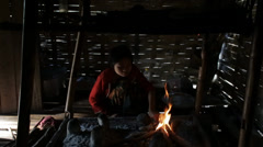 Getting the Cooking Fire Going in Burma Stock Footage