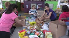Food being sorted at a food bank for the poor Stock Footage