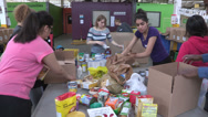 Stock Video Footage of Food being sorted at a food bank for the poor