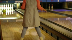 Stock Video Footage of bowling - a little girl knocks down pins and very glad