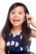 Girl talking on mobile phone Stock Photos
