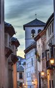 walking street church iglesia durante la eucarista carrera del darro albaicin - stock photo