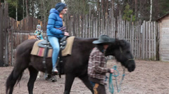 Children riding horses on a ranch Stock Footage