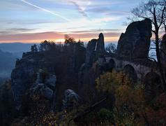Stock Photo of Early morning at old stony Bastei bridge, fog cloud is shaking  bellow