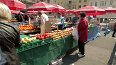 Steadicam shot of customers and sellers at Dolac market, Zagreb, Croatia Stock Footage