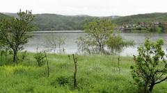 Flooding camp trailers on lake, landscape, weather forecast, tracking shot,25fps Stock Footage