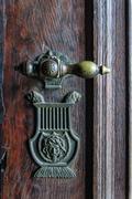 Vintage doorknob on antique door - stock photo