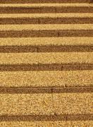 Straight lines of a concrete ladder, revetted with a small color pebbles Stock Photos