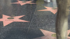 Timelapse people foot feet pass star walk of fame sidewalk pedestrian Hollywood  - stock footage
