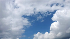 Clouds timelapse - White clouds flying on blue sky. Stock Footage