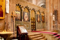 altar in the old historic catholic church - stock photo