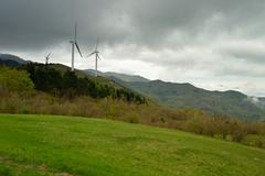 windturbines in the alps - stock photo