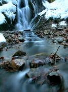Night winter view to frozen cascade of waterfall, icy twigs and icy boulders Stock Photos