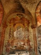 Abandoned countryside chapel with paiting. Devasted interier Stock Photos