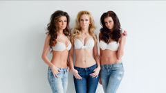 Trio of sexy shapely women in jeans and bras - stock footage