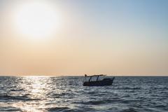 Fisherman boat at sea Stock Photos