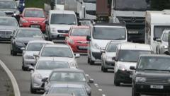 Long lens traffic approaching on the motorway Stock Footage