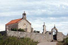 The church at the graveyard of Smokvica in Croatia Stock Photos