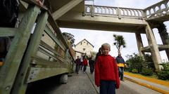 2 angles - tourist walk past Alcatraz watch tower - stock footage