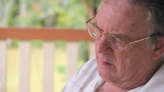 Tilt Down Man Playing Sudoku Game Stock Footage