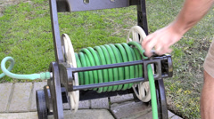 Rolling up hose - stock footage