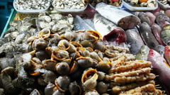 Fresh seafood: fish, shellfish are on the table. - stock footage