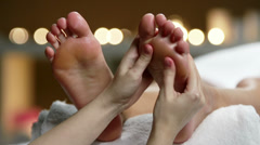 Giving Basic Foot Massage Stock Footage